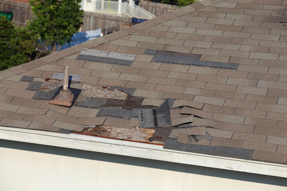 wind damage to roof shingles repair shingle restoration contractor